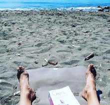 Reading stories of the first students of Ashtanga Vinyasa on the beach in Malaga