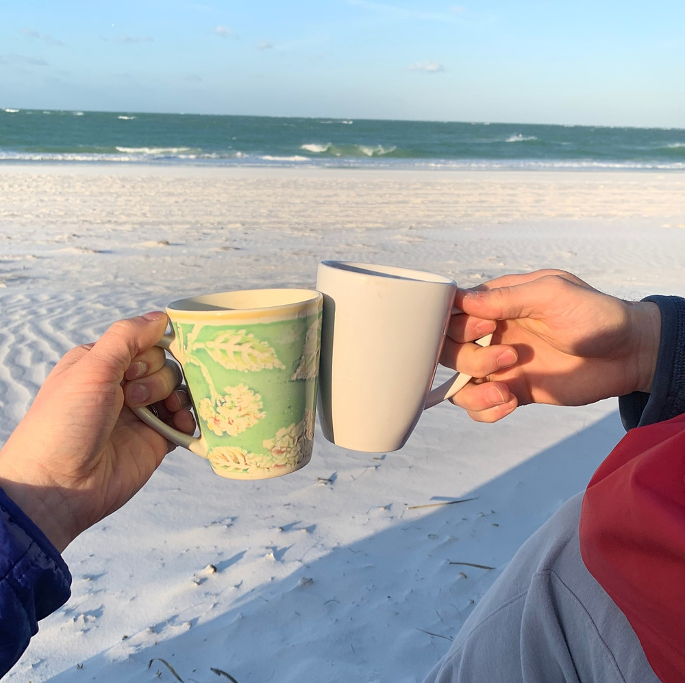 Drinking coffee on the beach