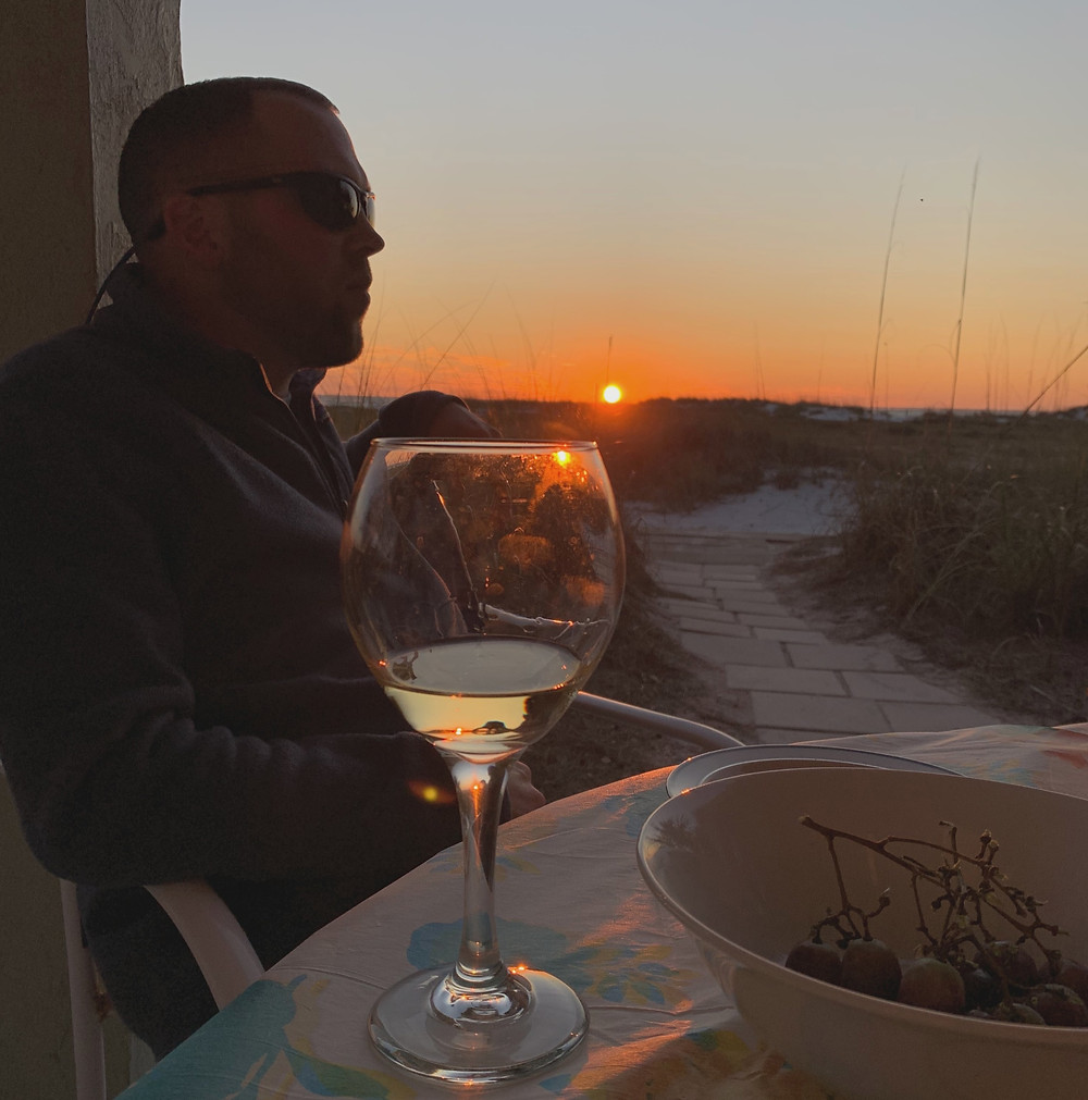 Sunset on sand dunes with wine