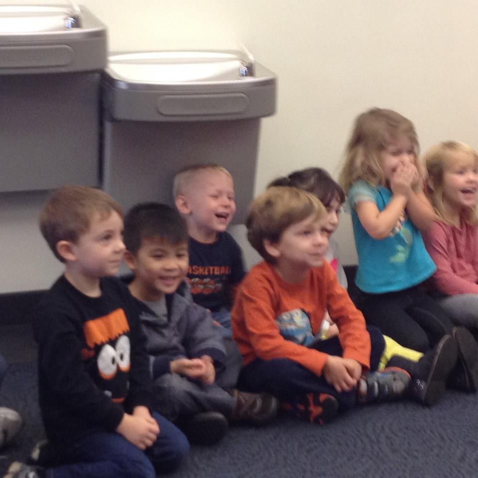 4 Year Olds Enjoying A Lively Story