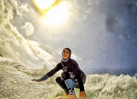 Women riding waves in Iran
