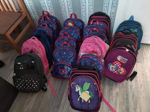 19 More Children received Backpacks filled with school supplies