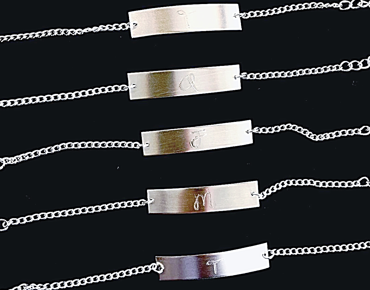 Personalized, engraved sterling silver bridesmaids bracelets. Engraved initial on the front and engraved date of the wedding on the back.