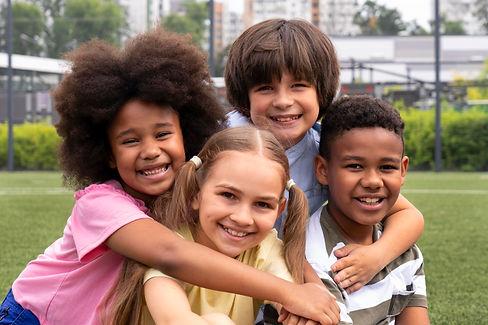 medium-shot-smiley-kids-posing-together.jpg