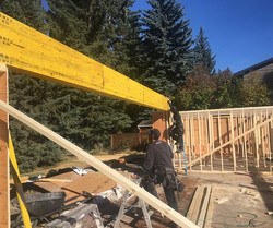This 28', 4-ply 20_ LVL beam will allow for one absolutely massive sliding door. The entire wall wil