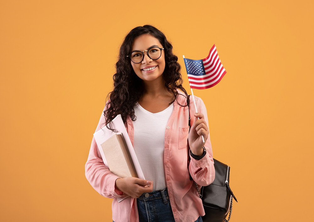 Student with books and an American flag