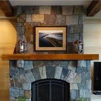 Custom Mantel On A Stone Fireplace
