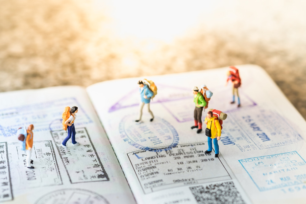 Travelers with backpacks on a passport