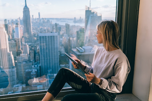 woman looking out of a window in New York
