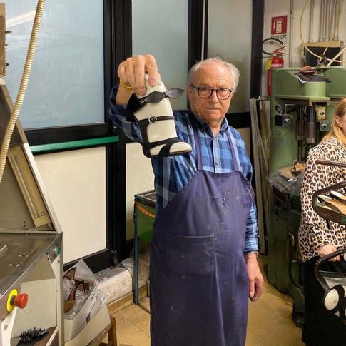 Italian Worker Showing Off Handmade Designer Shoes