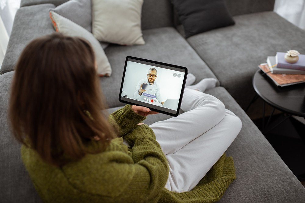 A virtual appointment with a woman and doctor