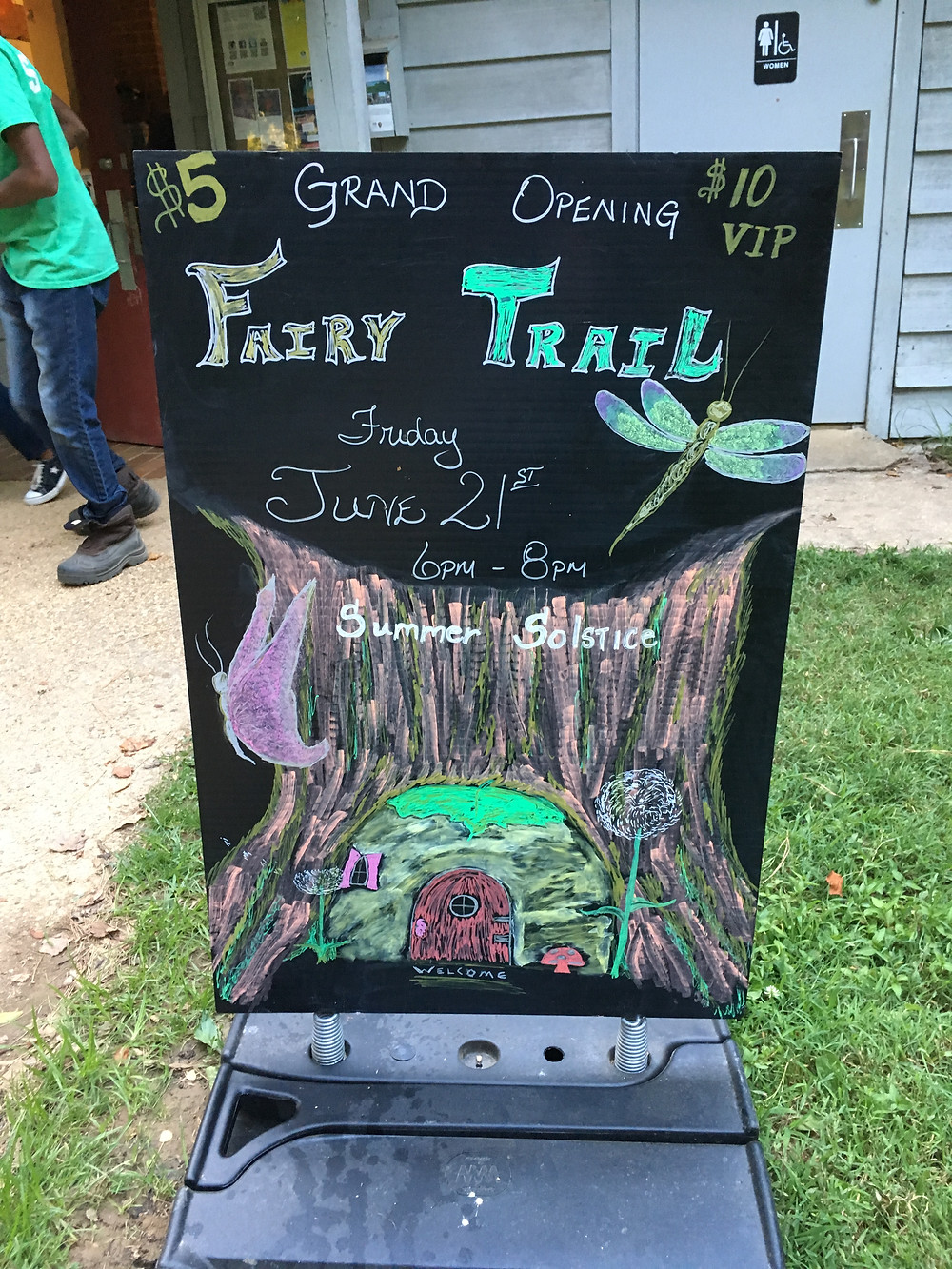 The sign for the fairy trail grand opening event