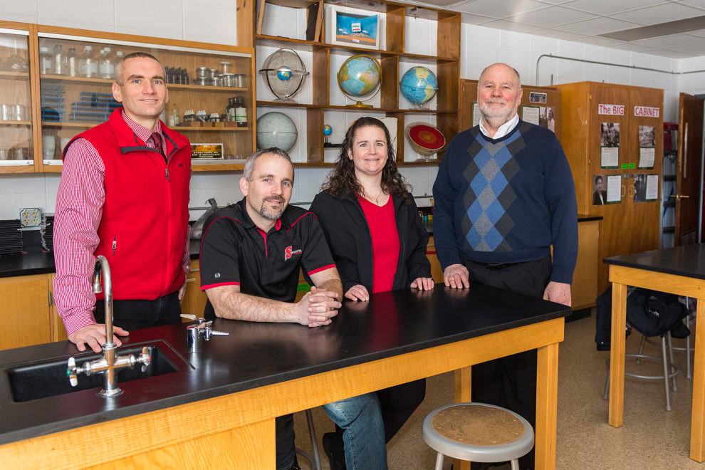 Chad Andreae, Bradley Andreae, Amy Barnard and Brad Andreae in a classroom at Sevastopol School. The Andreae's company, Therma-Tron-X, donated $2 million to outfit the school's new FabLab. Photo by Len Villano.
