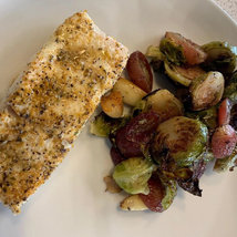 Baked Flute Fish with Roasted Brussel Sprouts, Caramelized Red Grapes and Garlic