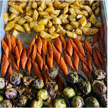 Roasted white sweet potatoes, ginger-infused carrots, red & green brussel sprouts, red onions and sliced garlic
