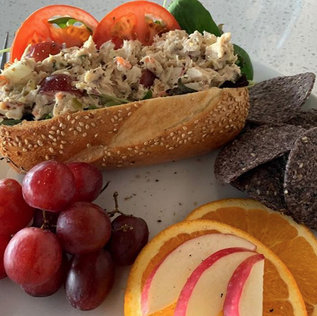 Red Salmon Salad on a Sesame Roll, w/spinach, sliced tomatoes and sliced fruit
