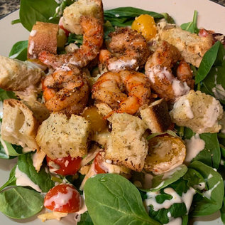 """Baby Spinach Salad"" w/ cherry tomatoes, almonds and seeds. Topped with shrimp, sourdough croutons and cashew dressing drizzle"