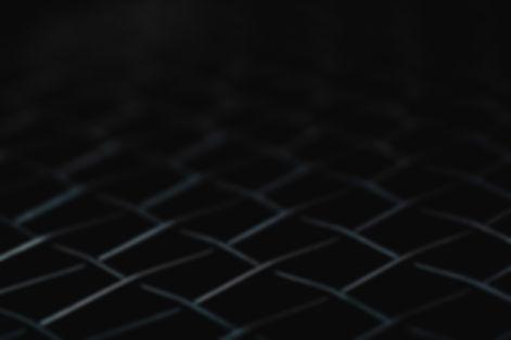 macro shot of black net tennis racket fo