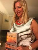 Denise half body holding JW book - promo
