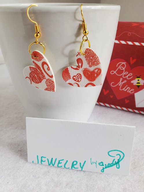 Red hearts on white background Faux Leather Hearts with gold-tone wires