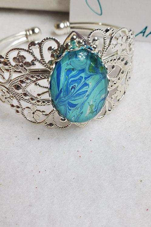 Artistic Acrylic Fancy Cuff Ocean Blue Oval Bracelet on Silver-tone met
