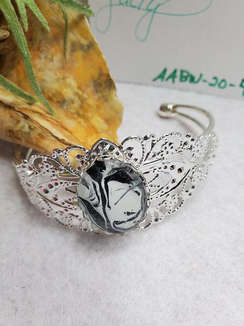 Artistic Acrylic Fancy Cuff Black/White Oval Bracelet on Silver-tone metal