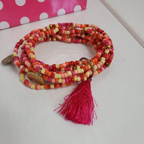 Fushia set of 9 Seed Bead Bracelets w/tassel on stretchy band