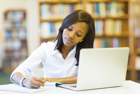 pretty female college student studying i