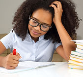 schoolgirl with glasses doing homework