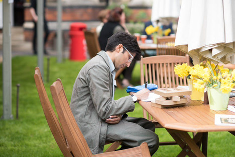 young man writing on garden table spring