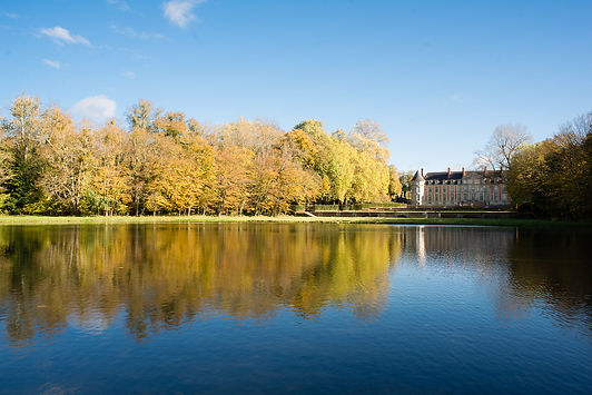 Back of Château Fleury with lake