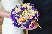 purple-bridal-bouquet-close-1249561996.j