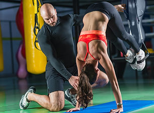 personal-trainer-with-woman-in-the-gym-P