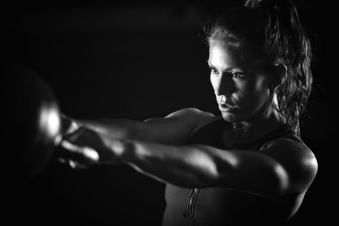 woman-athlete-exercising-with-kettlebell