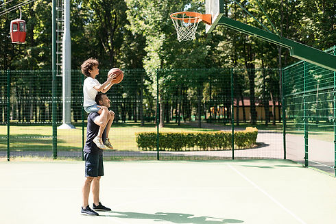 man-helping-his-son-to-score-a-basket-MX
