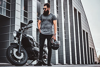 portrait-of-bearded-biker-chilling-with-his-motorb-2021-04-04-05-33-42-utc.jpg