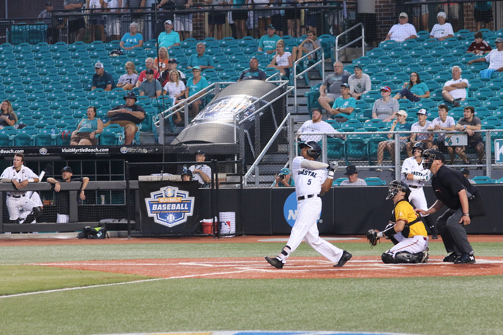 Kieton Rivers blasts a home run during the championship game.