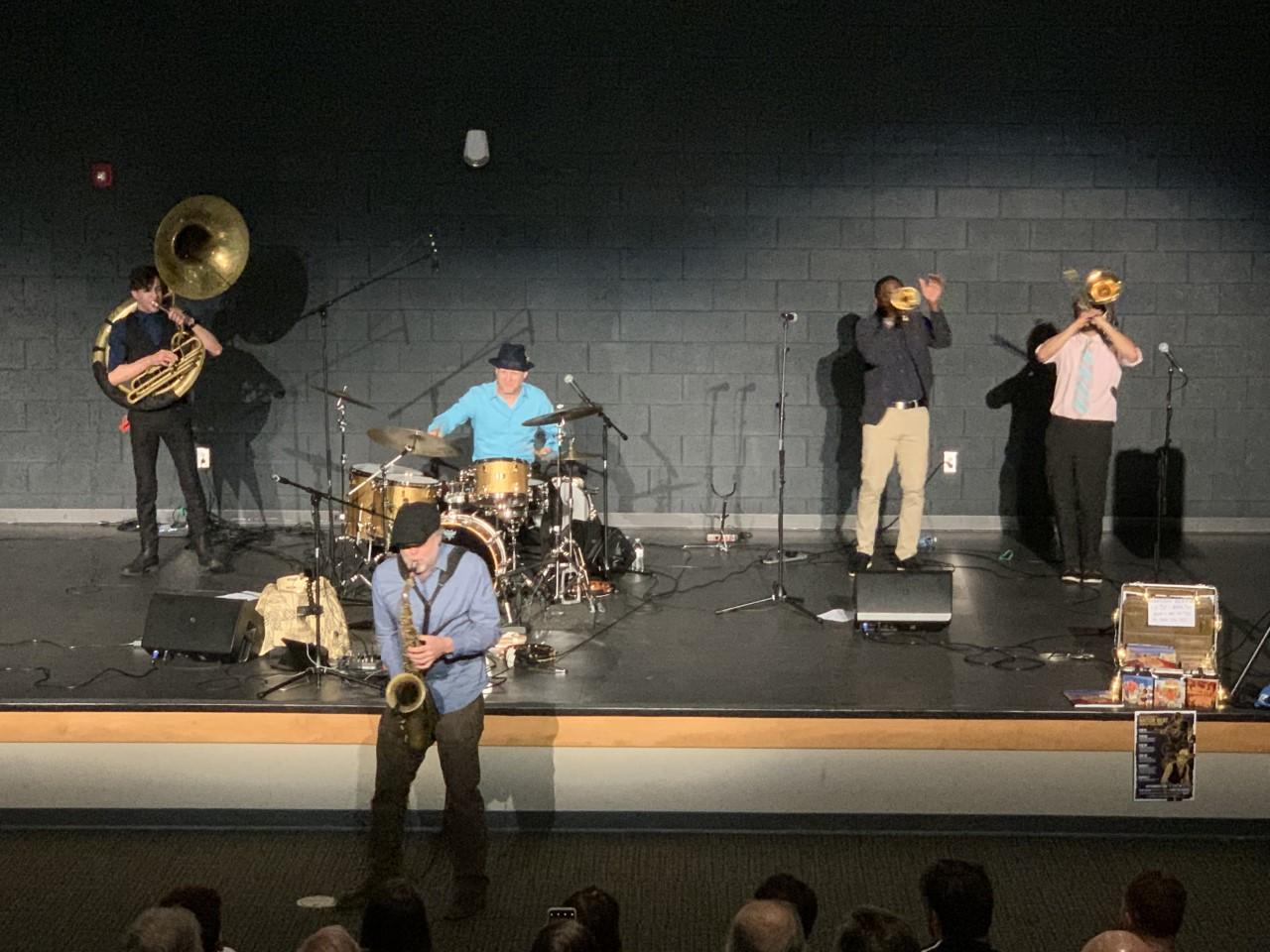 Tenor sax musician showing off his skill