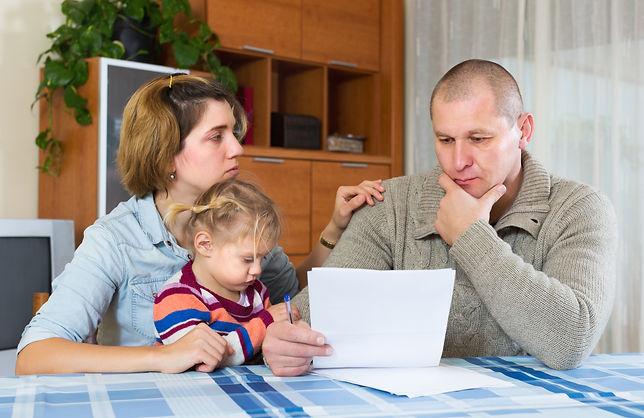 Sad Family Sitting Bills