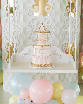 Birthday cake for birthday party that's carnival themed and pastel pink