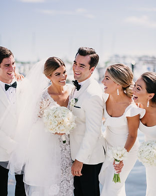Bride and Groom with bridal party wearing all whhite
