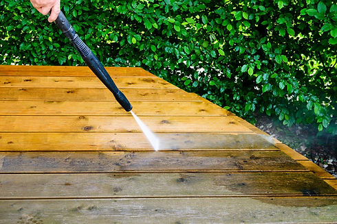 homeguide-power-washing-a-deck-before-an