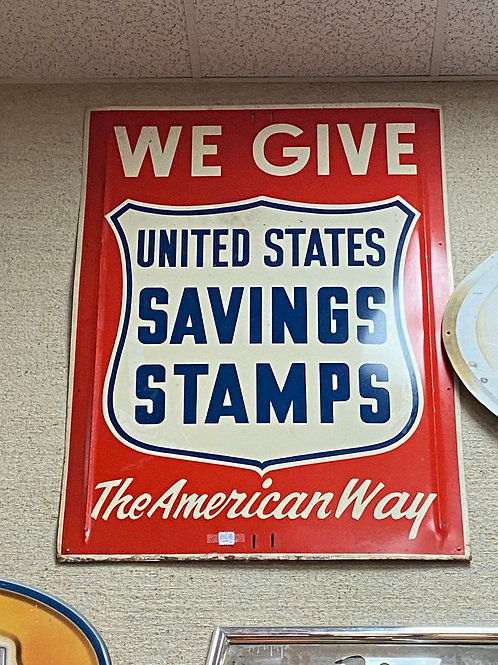 TEXAS TRAILS: World War II Red, white and blue propaganda saving stamps sign.