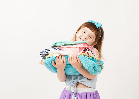 Canva - Smiling girl holding a stack of