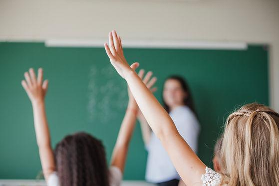 children-classroom-raising-hands.jpg