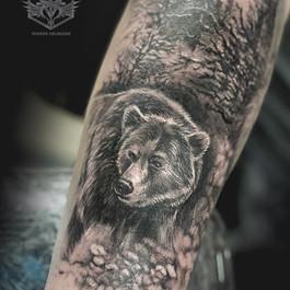 Bear and nature tattoo