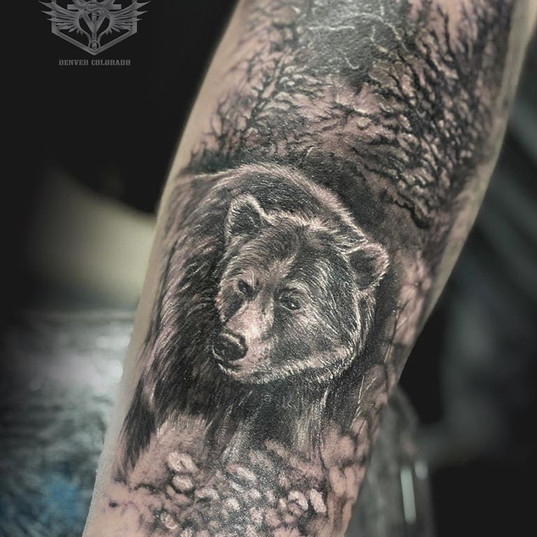Bear and nature tattoo