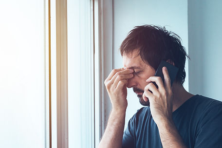 Stressed male talking to therapist on the telephone