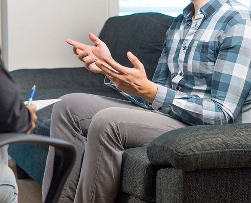 Man talking to counsellor in therapy