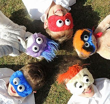 Children wearing Furchester Hotel (muppet) masks for taste testing at  CBeebies Big Day Out